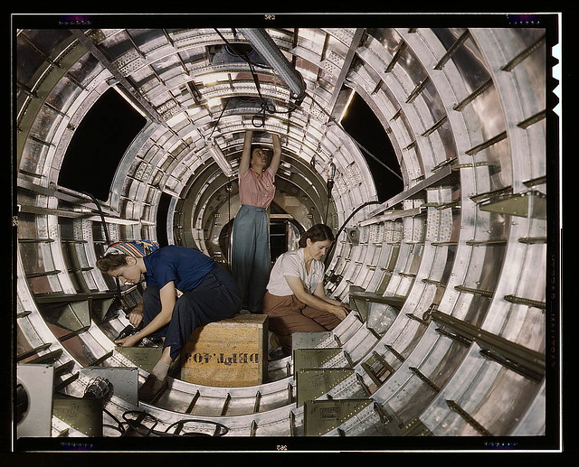 "Women workers install fixtures and assemblies to a tail fuselage section of a B-17F bomber at the Douglas Aircraft Company, Long Beach, Calif. Better known as the ""Flying Fortress,"" the B-17F is a later model of the B-17 which distinguished itself in acti"