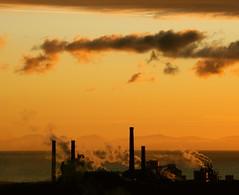 Industrial (Simone Mantovani) Tags: tramonto nuvole mare ombre vista colori riflessi oro fumo solvay contrasto mywinner industrializzazione goldstaraward genialed