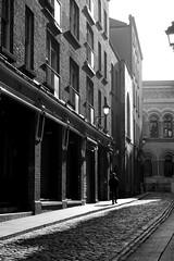 A walk in the sun (Dave Shiel) Tags: street shadow urban white black sunshine cobbles