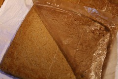 Turn cake out onto sugar dusted kitchen towel and remove waxed paper