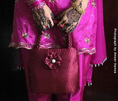 Celebrating Eid-ul-Fitr (Ameer Hamza) Tags: pink red woman girl female holding hands hand shot d70 designer embroidery patterns touch d70s eid happiness national purse excellent pakistani charming henna dye coloured hold geographic mehndi pigment hamza finest dyed islamic hena decorated bangles decked ameer finery ngm eidi girlspurse mehndipatterns handdesign ameerhamza churian adhia simplemehndi lpbest2007 handpatterns easymehndi mehndidesignsforeid simplemehndipatterns pakistanimehndidesign newmehndidesigns karachimehdidesine ppo1