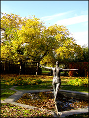 She is Careful 2 (R A Pyke (SweRon)) Tags: park autumn trees light sculpture woman colour green art public leaves yellow statue bronze sweden outdoor body seasonal bodylanguage Örebro lone balance olympussp510uz