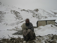 An Afghan man watches the road near Salang