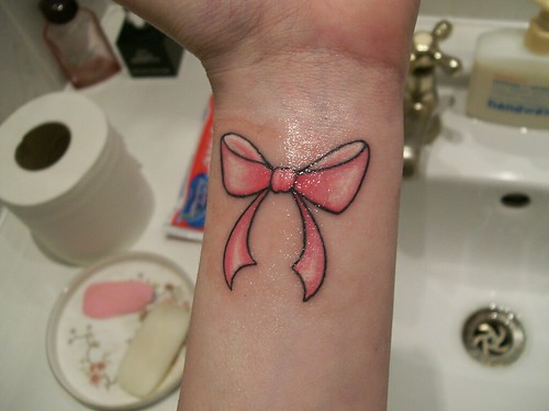 girl with tattoo. ink. pink bow