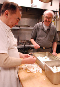 John Lee and Al Mitchell prepare a meal at the Lookout shelter.