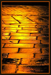 Streets paved with gold (Scippy) Tags: light streets rain gold pavement atmosphere soe streetlighting notavanishingpoint superaplus aplusphoto superbmasterpiece diamondclassphotographer streetspavedwithgold colourartaward artlegacy wetpavments