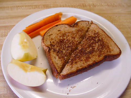 Carrots, pink lady apples, and grilled cheese sandwich