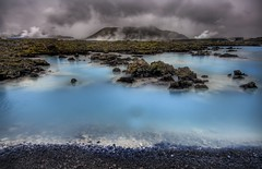 Approaching the Blue Lagoon (Stuck in Customs) Tags: blue wild panorama black pool clouds wonderful photography iceland scary earthquake nikon bath rocks raw photographer superb earth details perspective blues fresh steam haunted hardcore horror pro zombies scare magical geothermal hdr bluelagoon icelandic mindblowing rift themoulinrouge firstquality pockmarked geothermals stuckincustoms treyratcliff