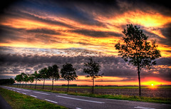 the sunrise (Jimbography ;-)) Tags: road morning blue trees light red sun green yellow clouds hdr drenthe themoulinrouge firstquality jimba mywinners abigfave impressedbeauty 3raws vision100