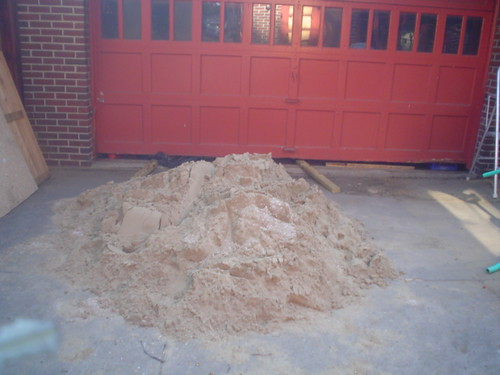 Sand pile by garage