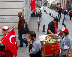 stiklal red from the tram (Peace Correspondent) Tags: street red urban turkey d50 nikon antique candid flag muslim trkiye nuts culture tram pedestrian social streetscene istanbul turquie trkorszg trkei chestnut vendor snacks streetcar istanbul taksim streetscape streetpeople socialdocumentary 2007 republicday muslimculture tirkiye taksimsquare istiklalcaddesi hotnuts stolenmoment cumhuriyetbayrami views200 5photosaday kestaneci modernistanbul turkishculture republicanday independencestreet nostalgictram peacecorrespondent
