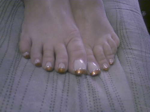Creative toe nail art. French pedicure design with beautiful toe nail art