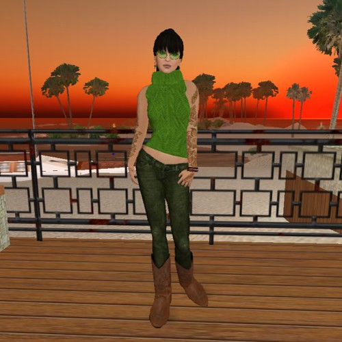 green outfit in front of sunset