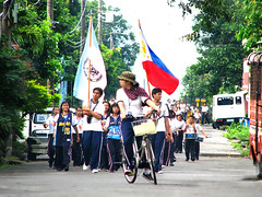 Just follow me! (Edmond Valerio) Tags: road trees houses cars children philippines flags laguna drummers edmond philippineflag valerio constantino canlubang mywinners schoolparade superbmasterpiece art125 canonpowershots5is ifpo