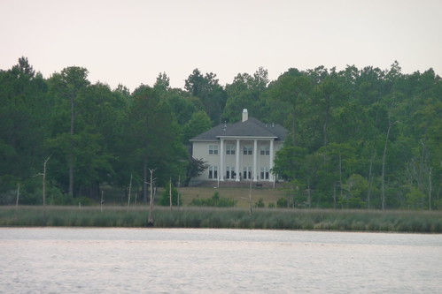 Large columned house across river