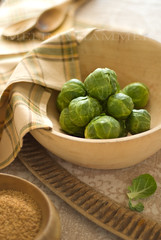 brussel sprouts (mwhammer) Tags: wood autumn light stilllife food brown color green texture yellow raw bright display rustic row fresh explore earthy spices pile round bunch bowls brussel sprouts neutral uncooked propstyling foodstyling melinahammer