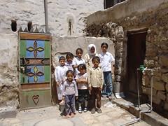 An ancient wooden and a modern iron door in Sanaa (olga_rashida) Tags: door children hijab kinder yemen sanaa tür jemen diamondclassphotographer