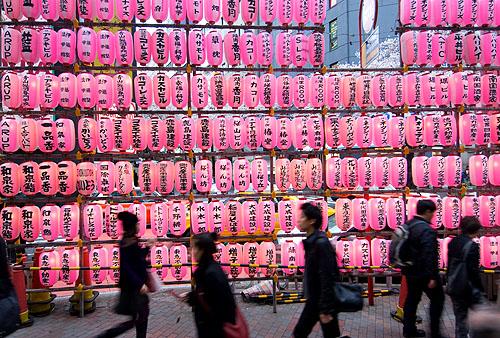 Paper lanterns line a street in Shibuya, Tokyo, Japan.