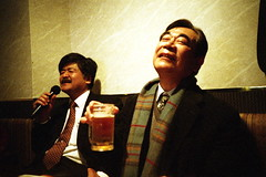 moment of enka (troutfactory) Tags: film beer japan lomo lca singing drinking rangefinder farewellparty  karaoke  osaka analogue kansai  toyonaka  enka natura1600