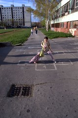 a girl playing hopscotch (cosmic[SGA]) Tags: city people spring nikon europe slovakia 2008 bratislava martina urbanlandscapes panelaky petrzalka krizikova d40 sidlisko