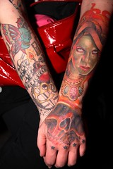 Cara's Forearms (Mikey Brick) Tags: people woman girl tattoo bar club austin butterfly stars skull bomb medusa forearm noose hourglass brassknuckles room710 gorgon lovethyneighbor bymiketravis do512 2008miketravis caramassacre