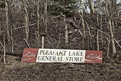 Sign of Another Time (brucetopher) Tags: tree woods trash junk antique decay old rotten ugly blemish forest litter dump junky path store shop sign signage generalstore general red cocacola cola coke pleasantlake