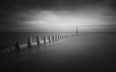 The High Line (ghostedout) Tags: ancient natural landscape old bnw walking outdoor light cromer infrared cloud infra black uk white 1750mm england winter sigma mono dramatic sky outdoors cold sea drama seaweed d7100 beach 1750 nature defence ocean coast grey blackandwhite seascape groyne ir norfolk walk monochrome seaside pier