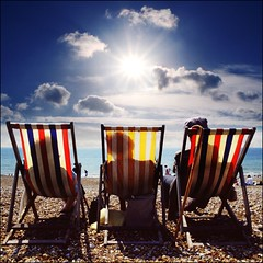 The observers (adrians_art) Tags: sea sky people cloud beach water sussex coast holidays brighton shadows relaxing shore peebles sunburst summertime sunbathing deckchairs