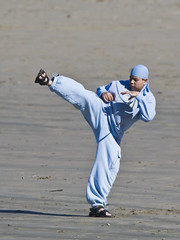 Hispanic individual practices martial arts at Morro Rock, Morro