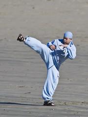 Hispanic individual practices martial arts at Morro Rock, Morro