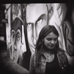 Talk without speaking (Celeste) Tags: streetart 120 6x6 film graffiti holga buenosaires faces jaz mart beautifulgirl ilfordfp4 celesteromero