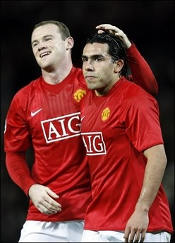Carlos Tevez and Rooney