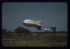 Marine Corps barrage balloons, Parris Island, S.C.  (LOC) (The Library of Congress) Tags: tree field 35mm vintage silver marine hotair balloon flight zeppelin ufo slidefilm 1940s helium transparency blimp libraryofcongress marinecorps dirigible transparencies lighterthanair colorphotograph barage historicalphotographs silverskin barrageballoon xmlns:dc=httppurlorgdcelements11 dc:identifier=httphdllocgovlocpnpfsac1a35173