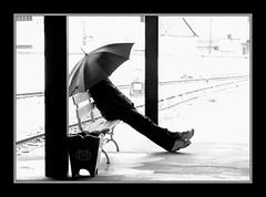 Sitting in the Railway Station (claudio.marcio2) Tags: bw bravo pb railwaystation estaoferroviria allyouneedislove firstquality creativephoto breathtakiing flickrgoldgroupaward anawesomeshot ithinkthisisartaward diamondclassphotographer flickrdiamond astoundingimage blackwhitegallery superamazingshotsaward photonawardsgroup bestphotographersmelhoresfotografos atravsdetumirada atravsdaminhalentethroughmylens artoftheblackwhiteemotions rahmenrahmenbwonly