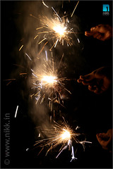 A sparkling night (:: niKk clicKs ::) Tags: india festival night canon lights hands kiss kerala sparklers celebrations cochin crackers chakra vishu nikk chakram mywinners canoneoskissdigitalx theperfectphotographer picnikk    asparklingnight malayalamnewyear