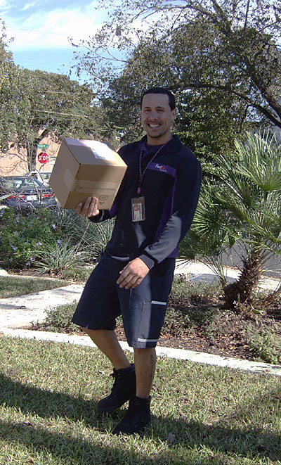 The FedEx delivery man with my new camera