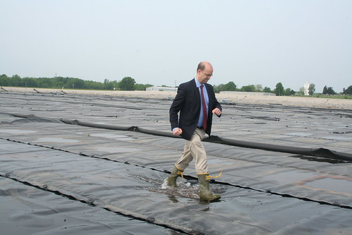 Jonathan Adelstein, USDA Utilities Administrator, walking on (waste) water at the City of Fayette lagoon.