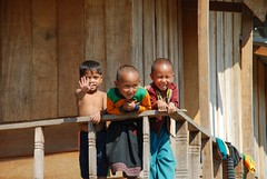 Children waving and smiling on balcony (Noel Molony) Tags: family children rice health stories waterpumps healthcentre monvillage concernstaff educationonhealth hamkongvillage haumeuangdistrict pakhataivillage pasortvillage salongvillage salorvillage samhouay sopkhamvillage tarkaivillage thathvillage