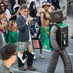 It's not easy shooting the Bay to Breakers: Pants Down. (AGrinberg) Tags: sanfrancisco people money public robot whispering photographer ipod pants tate hula down skirt mcdonalds 2008 glance underpants baytobreakers onlyinsanfrancisco sfchronicle96hrs 7587pantsdown
