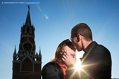 Young couple kissing at Red Square, Moscow, Russia (Konstantin Sutyagin) Tags: life city morning travel blue two sky people urban sun black tower love beautiful horizontal loving outdoors star photo hugging holding hug kiss kissing melting couple adult bright touch young dramatic lifestyle sunny landmark tourist romance clear relationship passion flare destination romantic casual rays copyspace date seduction redsquare shape russian embrace kremlin touching attraction feelings caucasian embracing spasskytower