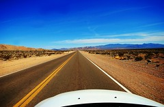 """On a Dark Desert Highway""  O.K., It's not dark. Sorry Eagles. (merriewells) Tags: desert roadtrip highways vanishingpoints wowiekazowie eyeofthephotographer"