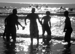 The Silver Surf Football Game  black/ white (moonjazz) Tags: ocean california sea wild summer sun men boys wet silhouette silver fun football cool surf shine play bright teens playa splash hombres diamondclassphotographer flckrdiamond flickrlovers
