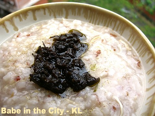 Rice Porridge topped with a dollop of Preserved Olive Leaves