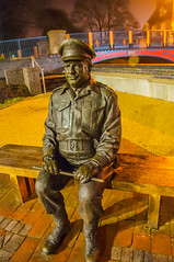 """Stupid Boy"" (Tony Shertila) Tags: 20170204232244 england gbr thetford unitedkingdom geo:lat=5241371382 geo:lon=074593037 geotagged europe britain norfolk captainmainwaring dadsarmy statue tribute night outdoor figure bench sitting"