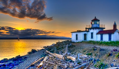 Sunset at West Point Lighthouse (moog55) Tags: seattle blue windows sunset red sky orange lighthouse mountains cold beach water glass silhouette yellow clouds sailboat reflections island nikon rocks waves windy pebbles dirt driftwood pugetsound olympics hdr gitzo discoverypark westpoint seagrass d90 giottos top20lh moog55