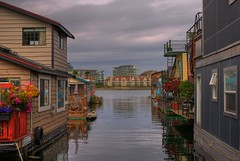 Fisherman's Wharf (Brandon Godfrey) Tags: world pictures flowers canada west water reflections landscape photography harbor scenery colorful day bc cloudy photos harbour pics earth britishcolumbia sony scene victoria vancouverisland creativecommons pacificnorthwest northamerica fishermanswharf vic colourful alpha dslr 2009 hdr houseboats jamesbay songhees a300 flowerbaskets psuedohdr singlerawfilehdr dslra300 sonya300 shutterssparesidences