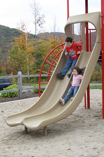 Sliding down the slide together