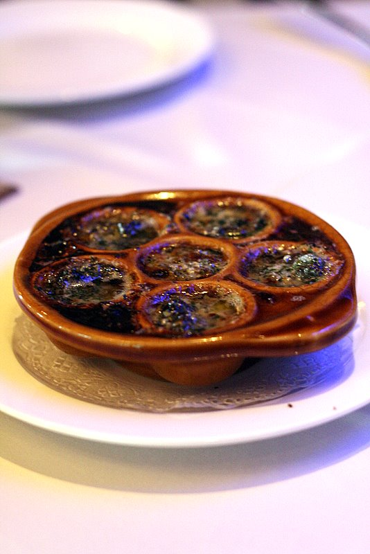 baked escargots in garlic and herb sauce