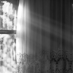 Let the sunshine in (macropoulos) Tags: light bw window topf50 500v20f curtain 500v50f rays canonef35mmf2 gettyimages 500x500 blueribbonwinner 1000v40f canoneos400d artlibre 50faves50comments500views diamondclassphotographer flickrdiamond artlegacy theperfectphotographer bachspicsgallery bwartaward gettyimages:date_added=pre20110607