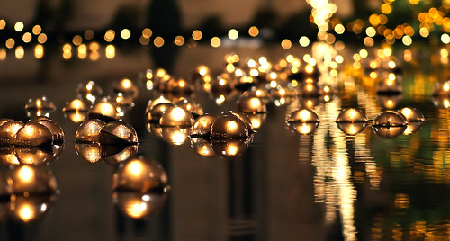 Floating Holiday Candles in Reflection Pool